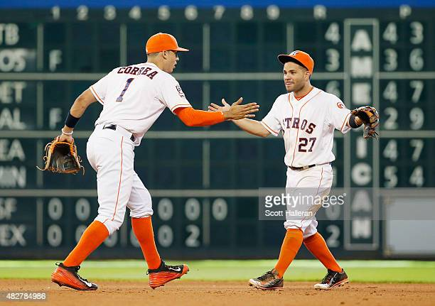 Carlos Correa and Jose Altuve of the Houston Astros celebrate in the infield after the Astros defeated the the Arizona Diamondbacks 41 at Minute Maid...