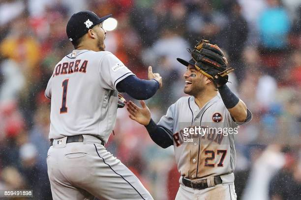 Carlos Correa and Jose Altuve of the Houston Astros celebrate defeating the Boston Red Sox 54 in game four of the American League Division Series at...