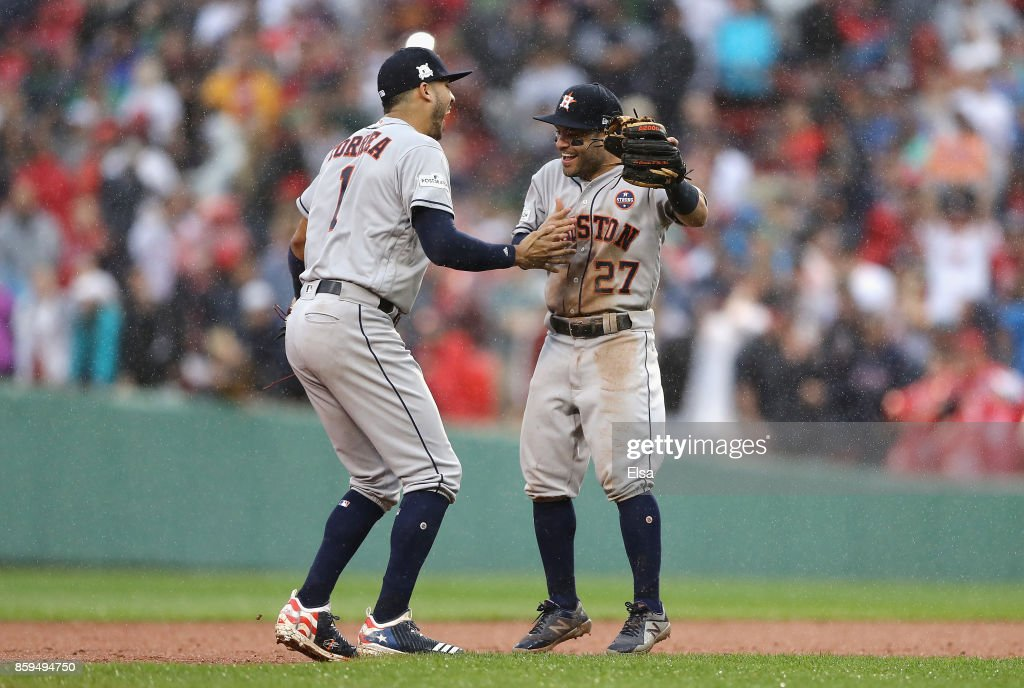 Carlos Correa #1 and Jose Altuve #27 of the Houston Astros celebrate defeating the Boston Red Sox 5-4 in game four of the American League Division Series at Fenway Park on October 9, 2017 in Boston, Massachusetts. The Houston Astros advance to the American League Championship Series.