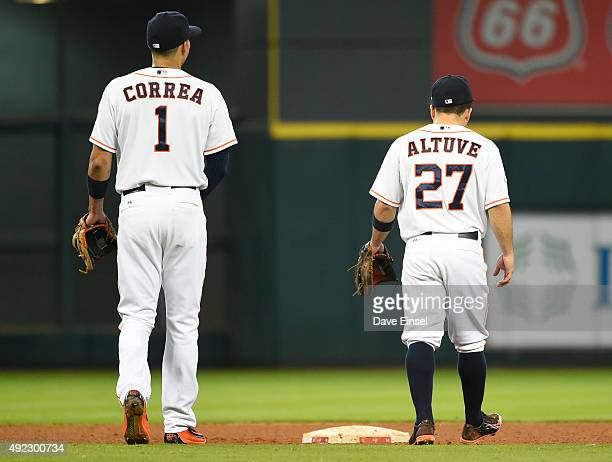 Carlos Correa and Jose Altuve of the Houston Astros look on during a pitching change during Game 3 of the ALDS against the Kansas City Royals at...
