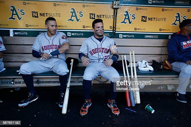 Carlos Correa and Jose Altuve of the Houston Astros sit in the dugout prior to the game against the Oakland Athletics at the Oakland Coliseum on July...