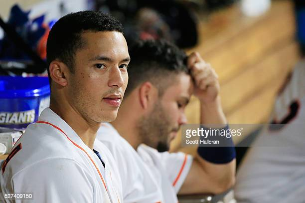 Carlos Correa and Jose Altuve of the Houston Astros wait in the dugout in the sixth inning of their game against the Minnesota Twins at Minute Maid...