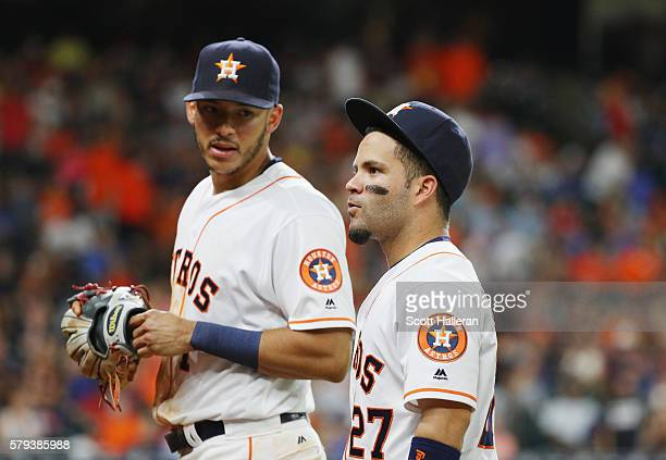 Carlos Correa and Jose Altuve of the Houston Astros walk back to the dugout during their game against the Los Angeles Angels of Anaheim at Minute...