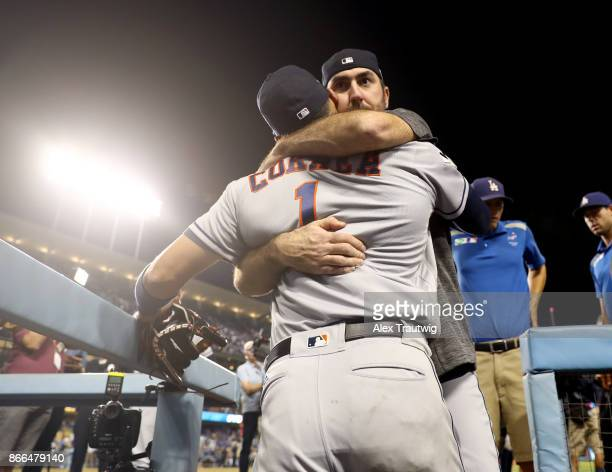 Carlos Correa and Justin Verlander of the Houston Astros celebrate after winning Game 2 of the 2017 World Series against the Los Angeles Dodgers at...