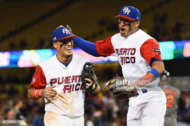 Carlos Correa and TJ Rivera of the Puerto Rico after a double play to end the ninth inning against team Netherlands during Game 1 of the Championship...