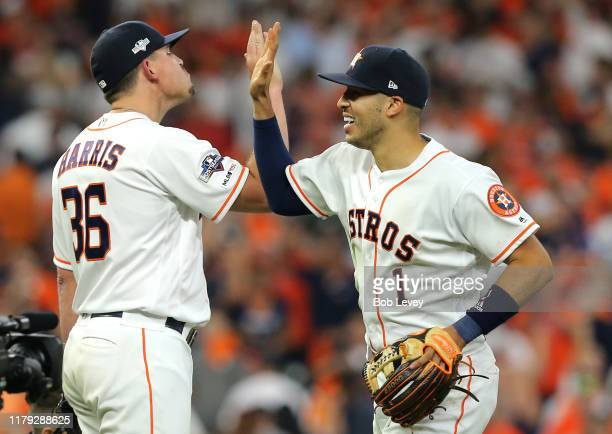 Carlos Correa and Will Harris of the Houston Astros celebrate after the Astros win Game 2 of the ALDS by defeating the Tampa Bay Rays 31 at Minute...