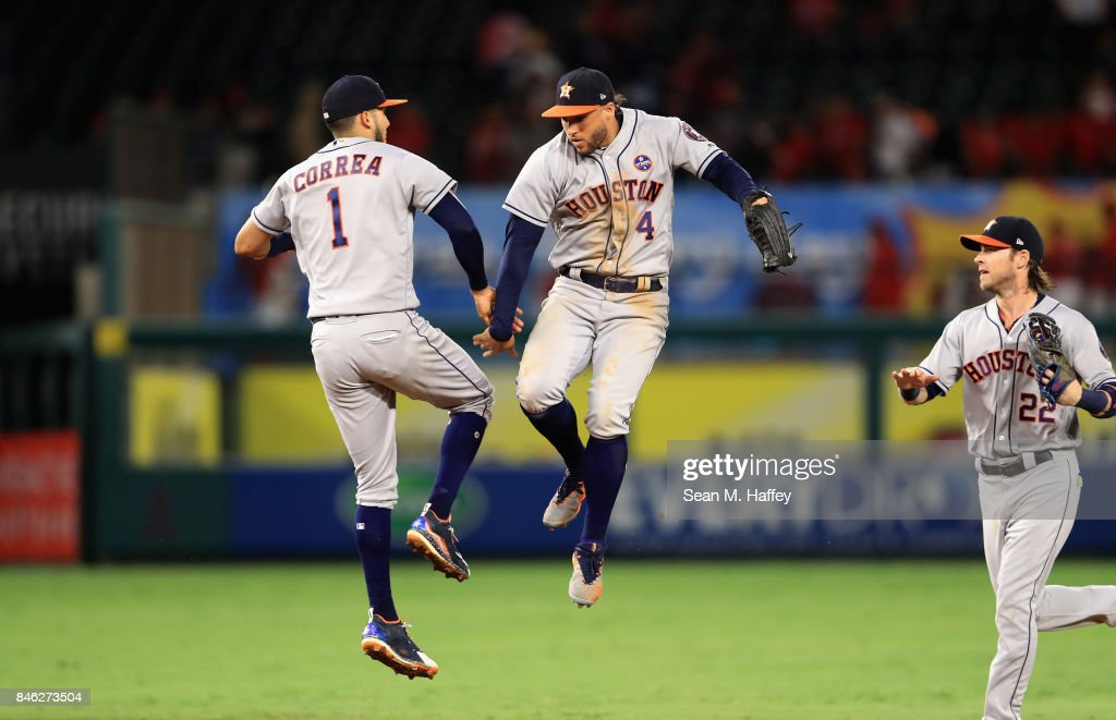 Carlos Correa #1, George Springer #4 and Josh Reddick #22 of the Houston Astros celebrate defeating the Los Angeles Angels of Anaheim 1-0 ina game at Angel Stadium of Anaheim on September 12, 2017 in Anaheim, California.