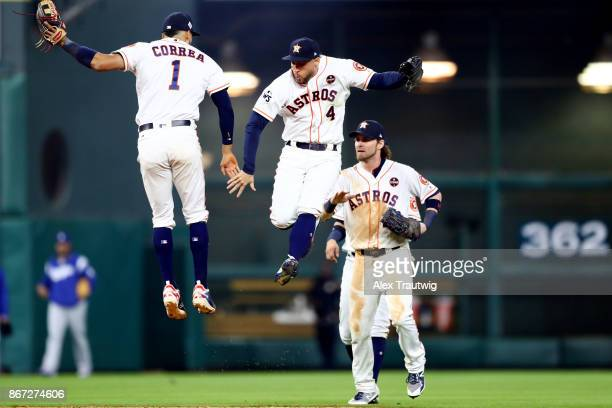 Carlos Correa George Springer and Josh Reddick of the Houston Astros celebrate after the Astros defeated the Los Angeles Dodgers in Game 3 of the...