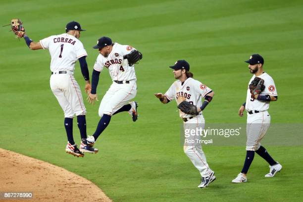 Carlos Correa George Springer Josh Reddick and Marwin Gonzalez of the Houston Astros celebrate after the Astros defeated the Los Angeles Dodgers in...