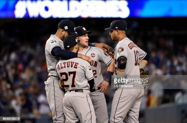 Carlos Correa Jose Altuve Alex Bregman and Yuli Gurriel of the Houston Astros huddle during Game 6 of the 2017 World Series against the Los Angeles...