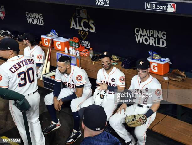 Carlos Correa Jose Altuve and Alex Bregman of the Houston Astros are seen in the dugout before Game 7 of the American League Championship Series...