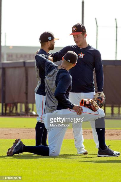 Carlos Correa Jose Altuve and Alex Bregman of the Houston Astros joke around during a spring training workout on Tuesday February 19 2019 at the...