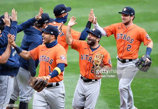 Carlos Correa, Jose Altuve and Alex Bregman of the Houston Astros celebrate defeating the Minnesota Twins in Game Two in the American League Wild...