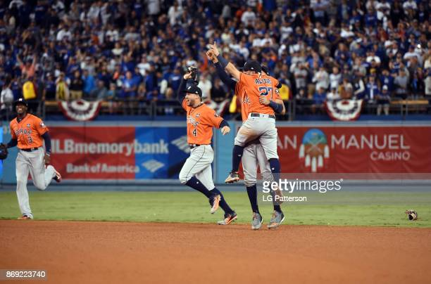 Carlos Correa Jose Altuve and George Springer of the Houston Astros celebrate after the final out of Game 7 of the 2017 World Series against the Los...