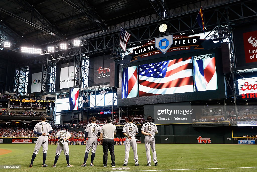 Carlos Correa #1, Jose Altuve #27, George Springer #4, Marwin Gonzalez #9 and Jake Marisnick #6 of the Houston Astros stand for a moment of silence, in honor of Memorial Day, before the MLB game against the Arizona Diamondbacks at Chase Field on May 30, 2016 in Phoenix, Arizona.