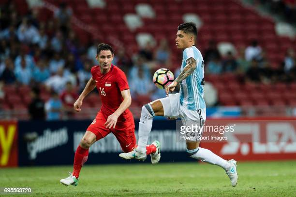 Carlos Correa of Argentina fights for the ball with Daniel Bannett of Singapure during the International Test match between Argentina and Singapore...