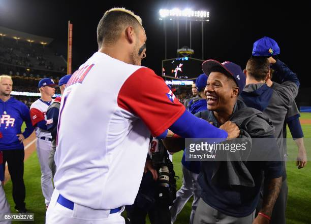 Carlos Correa of team Puerto Rico talks with Marcus Stroman of team United States after team USA's 80 win over Puerto Rico during Game 3 of the...
