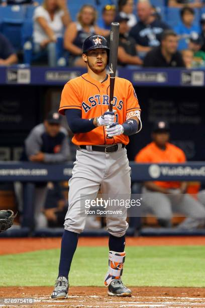 Carlos Correa of the Astros steps out of the batter's box to look at his bat during the MLB regular season game between the Houston Astros and Tampa...