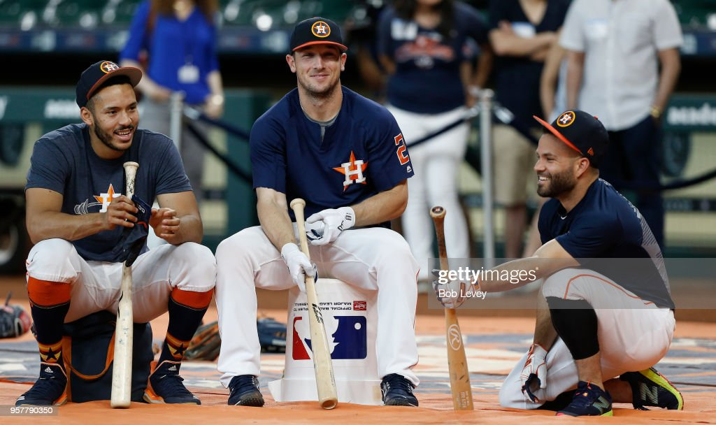 Carlos Correa #1 of the Houston Astros, Alex Bregman #2 and Jose Altuve #27 wait their turn for batting practice before playing the Texas Rangers at Minute Maid Park on May 12, 2018 in Houston, Texas.