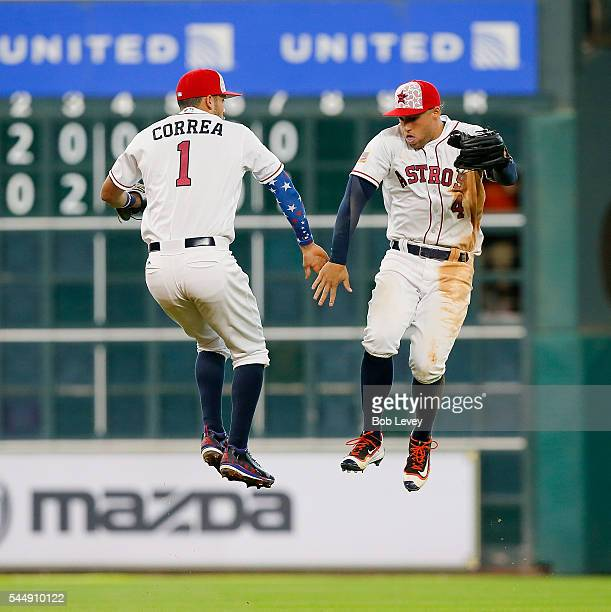 Carlos Correa of the Houston Astros and George Springer celebrate after the final out against the Seattle Mariners at Minute Maid Park on July 4 2016...