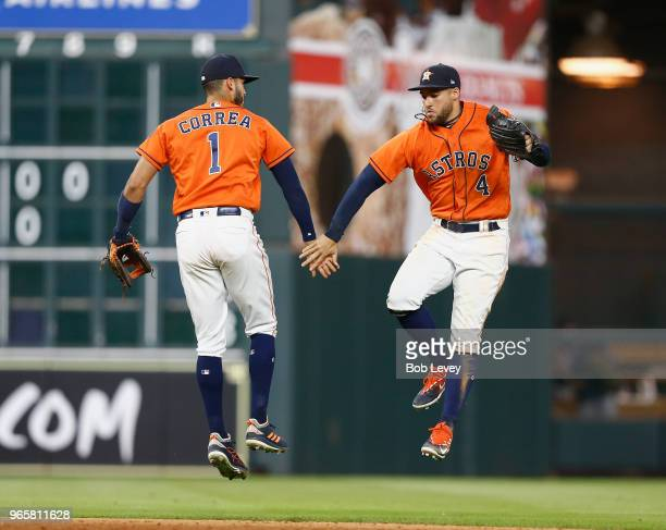 Carlos Correa of the Houston Astros and George Springer celebrate after the final out against the Boston Red Sox at Minute Maid Park on June 1 2018...