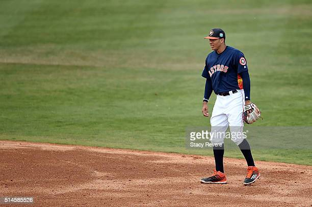 Carlos Correa of the Houston Astros anticipates a pitch during a spring training game against the Atlanta Braves at Osceola County Stadium on March 9...