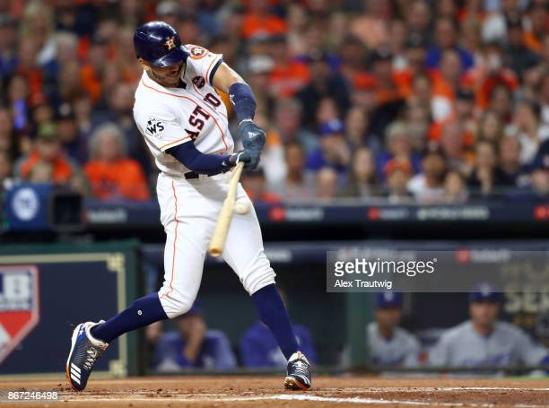 Carlos Correa of the Houston Astros bats during Game 3 of the 2017 World Series against the Los Angeles Dodgers at Minute Maid Park on Friday October...