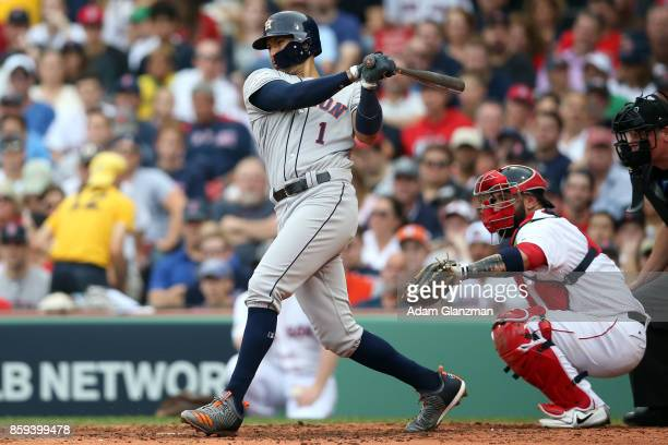 Carlos Correa of the Houston Astros bats during Game 3 of the American League Division Series against the Boston Red Sox at Fenway Park on Sunday...