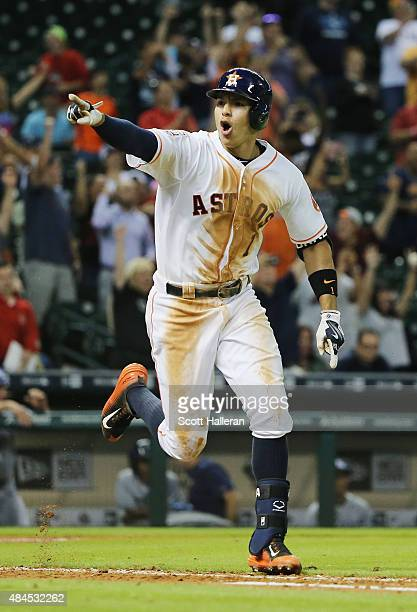 Carlos Correa of the Houston Astros celebrates after driving in the game winning run in the bottom of the 13th inning to defeat the Tampa Bay Rays 32...