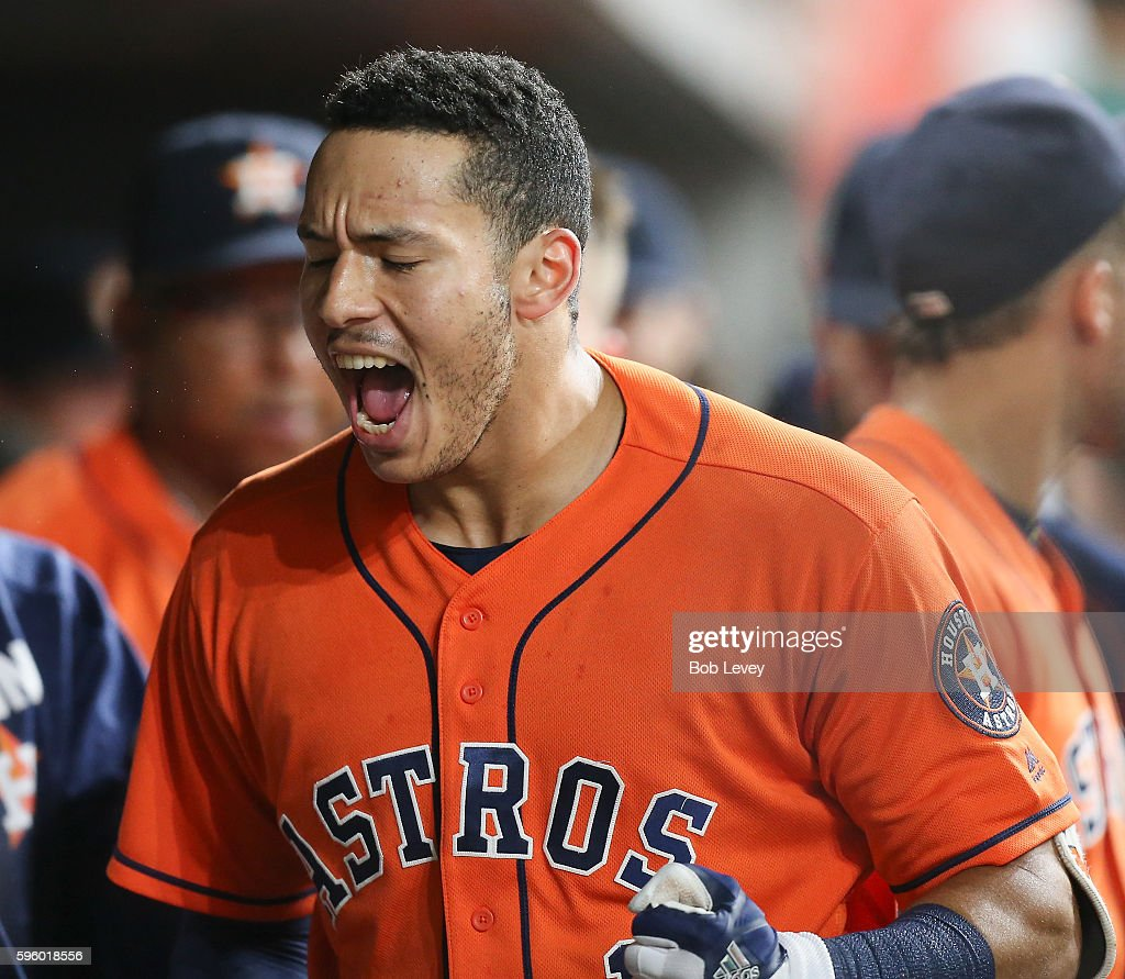 Carlos Correa #1 of the Houston Astros celebrates after hitting a home run in the ninth inning against the Tampa Bay Rays at Minute Maid Park on August 26, 2016 in Houston, Texas.