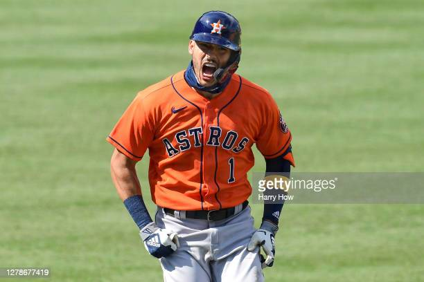 Carlos Correa of the Houston Astros celebrates after hitting a two run home run against the Oakland Athletics during the fourth inning in Game One of...