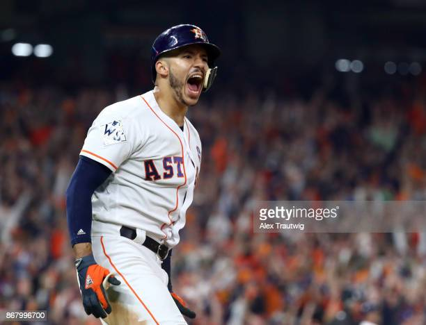 Carlos Correa of the Houston Astros celebrates after hitting a tworun home run in the seventh inning of Game 5 of the 2017 World Series against the...