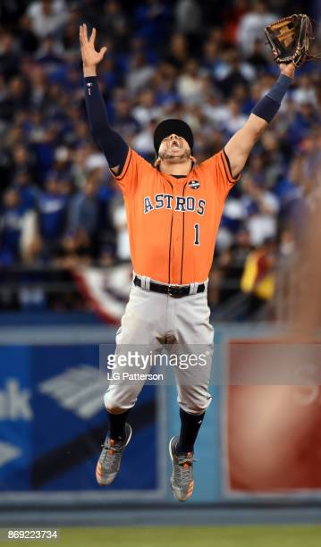 Carlos Correa of the Houston Astros celebrates after the final out of Game 7 of the 2017 World Series against the Los Angeles Dodgers at Dodger...