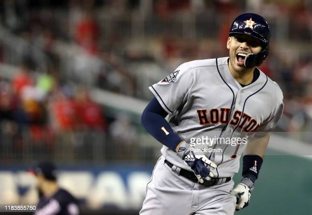 Carlos Correa of the Houston Astros celebrates as he rounds the bases on his two-run home run against the Washington Nationals during the fourth...