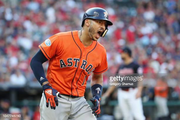 Carlos Correa of the Houston Astros celebrates as he runs the bases after hitting a threerun home run in the eighth inning against the Cleveland...