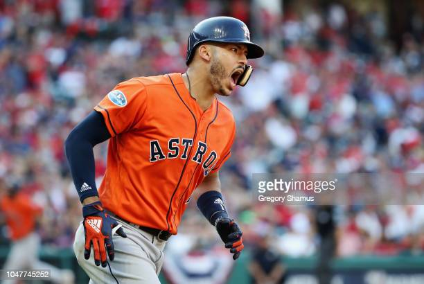 Carlos Correa of the Houston Astros celebrates as he runs the bases after hitting a three-run home run in the eighth inning against the Cleveland...