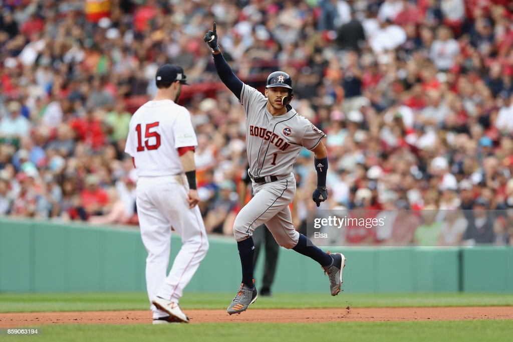 Carlos Correa #1 of the Houston Astros celebrates as he runs the bases after hitting a two-run home run in the first inning against the Boston Red Sox during game three of the American League Division Series at Fenway Park on October 8, 2017 in Boston, Massachusetts.
