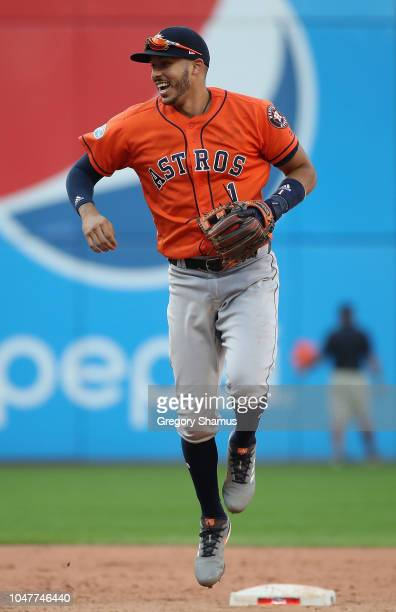 Carlos Correa of the Houston Astros celebrates defeating the Cleveland Indians 113 in Game Three of the American League Division Series to advance to...