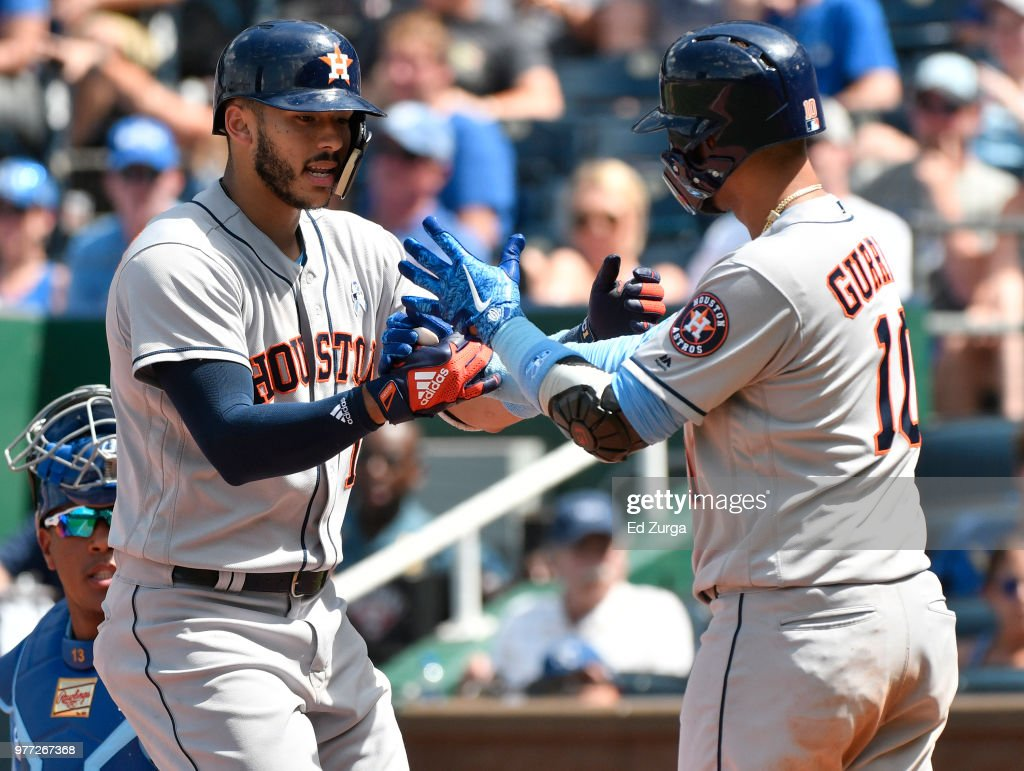 Carlos Correa #1 of the Houston Astros celebrates his home run with Yuli Gurriel #10 in the eighth inning against the Kansas City Royals at Kauffman Stadium on June 17, 2018 in Kansas City, Missouri.