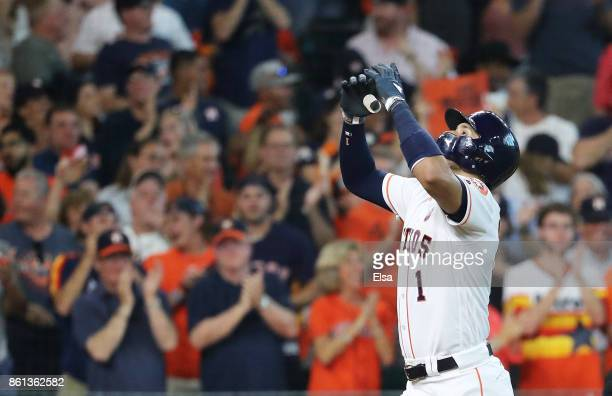 Carlos Correa of the Houston Astros celebrates his solo homerun in the fourth inning against the New York Yankees during game two of the American...