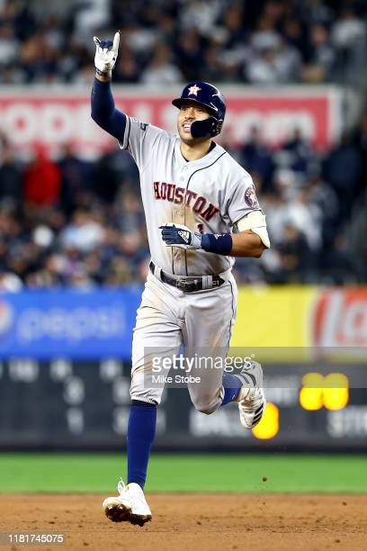 Carlos Correa of the Houston Astros celebrates his threerun home run against the New York Yankees during the sixth inning in game four of the...