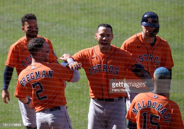 Carlos Correa of the Houston Astros, celebrates his two run homerun with Alex Bregman, to take a 4-2 lead over the Los Angeles Angels, during the...