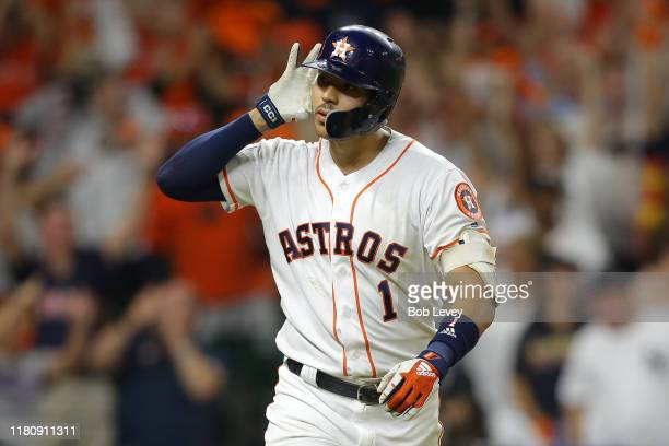Carlos Correa of the Houston Astros celebrates hitting a walk-off solo home run during the eleventh inning against the New York Yankees to win game...