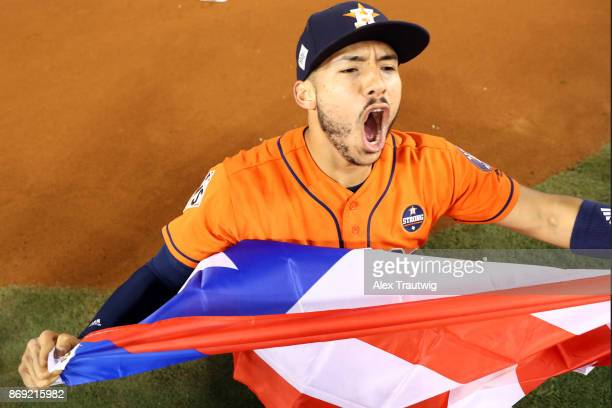 Carlos Correa of the Houston Astros celebrates on the field after the Astros defeated the Los Angeles Dodgers in Game 7 of the 2017 World Series at...