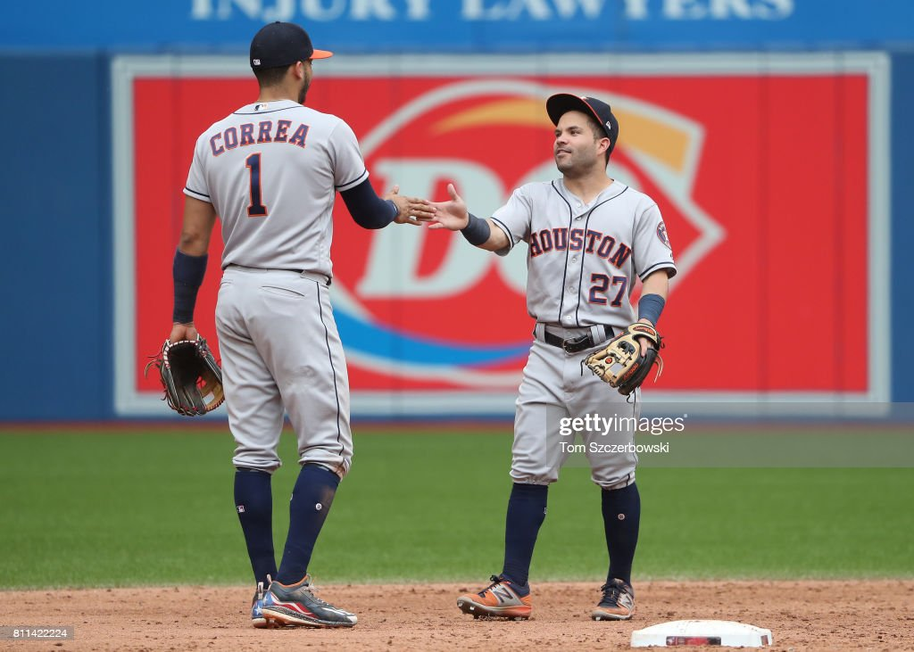 Carlos Correa #1 of the Houston Astros celebrates their victory with Jose Altuve #27 during MLB game action against the Toronto Blue Jays at Rogers Centre on July 9, 2017 in Toronto, Canada.
