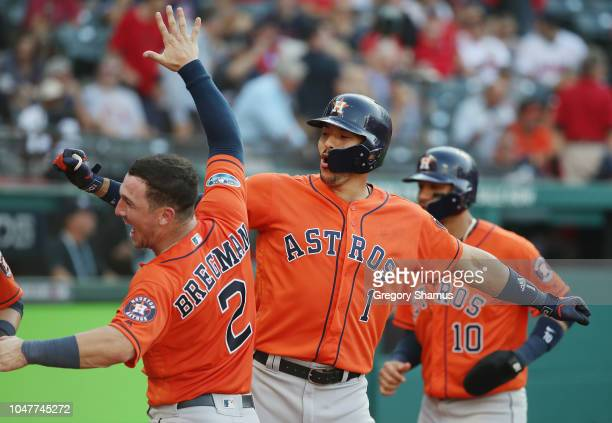 Carlos Correa of the Houston Astros celebrates with Alex Bregman after hitting a threerun home run in the eighth inning against the Cleveland Indians...