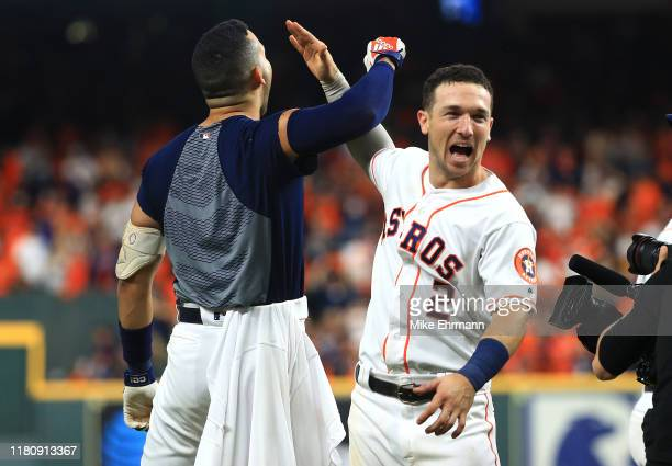Carlos Correa of the Houston Astros celebrates with Alex Bregman after hitting a walkoff solo home run during the eleventh inning against the New...