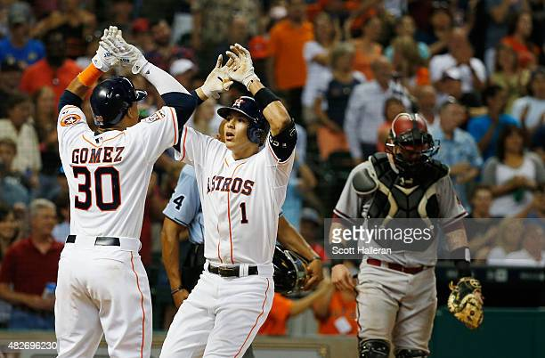 Carlos Correa of the Houston Astros celebrates with Carlos Gomez after Correa hit a tworun home run in the sixth inning during their game against the...