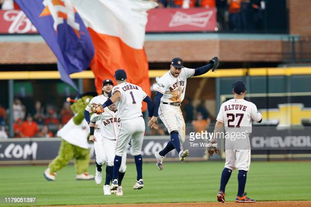 Carlos Correa of the Houston Astros celebrates with George Springer after defeating the Tampa Bay Rays 6-2 in game one of the American League...