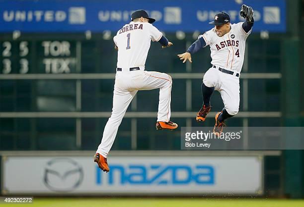 Carlos Correa of the Houston Astros celebrates with George Springer of the Houston Astros after the Houston Astros defeat the Kansas City Royals in...